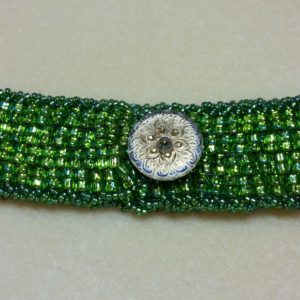 Artisan Peyote Green Bracelet. Beadweaving with decorative button and handsewn beautifully detailed closure handmade by Andrea Horowitz of Andrea Sherry Creations.